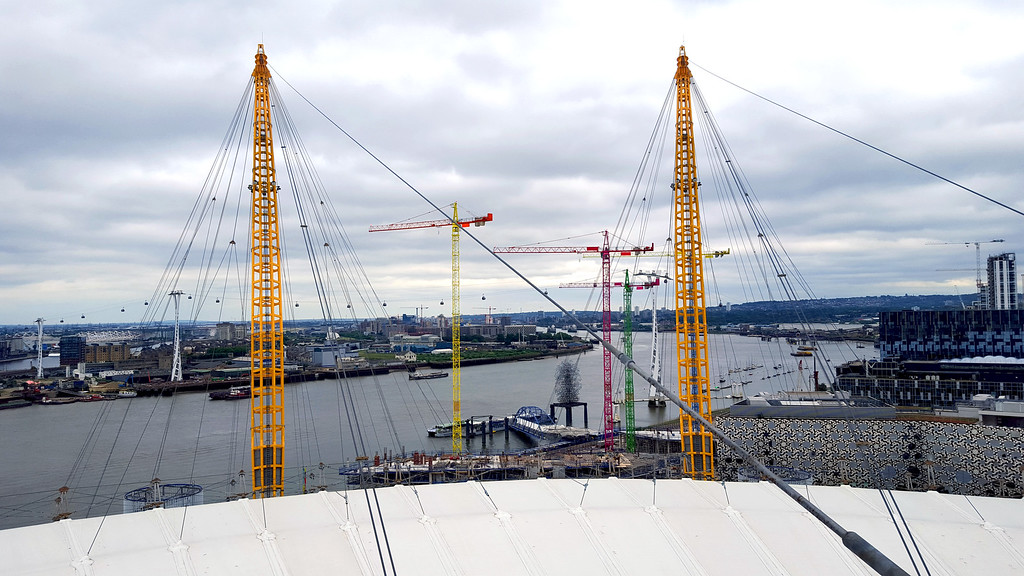 view towards colourful cranes in greenwich from the top of the 02 arena