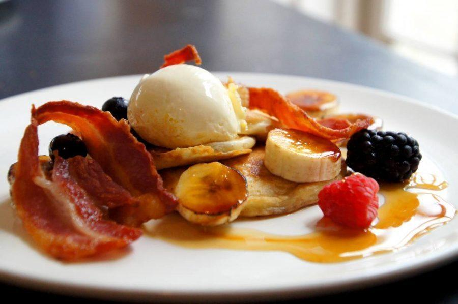Blueberry Pancakes with Crispy Bacon Clotted Cream and Caramelized Banana for breakfast at the bel and dragon in odiham image 4