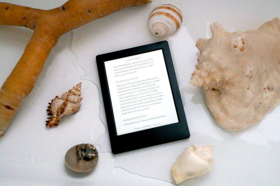 Kobo H2O Electronic reader surrounded by shells