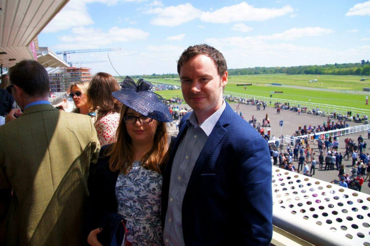 My husband and I on the terrace of the Fred Winter Suite of the Newbury Racecourse main field on al shaquab lockinge day