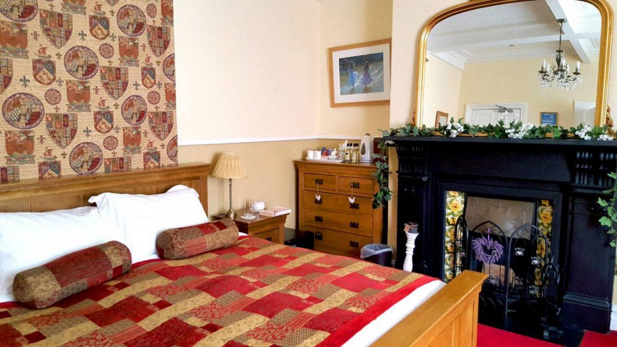 bedroom with fireplace of victoria bed and breakfast in caernarfon in snowdonia wales