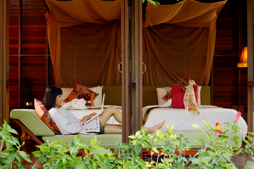 bench in bedroom in guest cabin at zeavola resort on Ko Phi Phi Island seen from outside