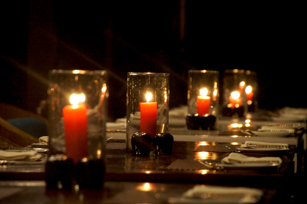 candles on table in restaurant baxil at zeavola resort on Ko Phi Phi Island seen from outside