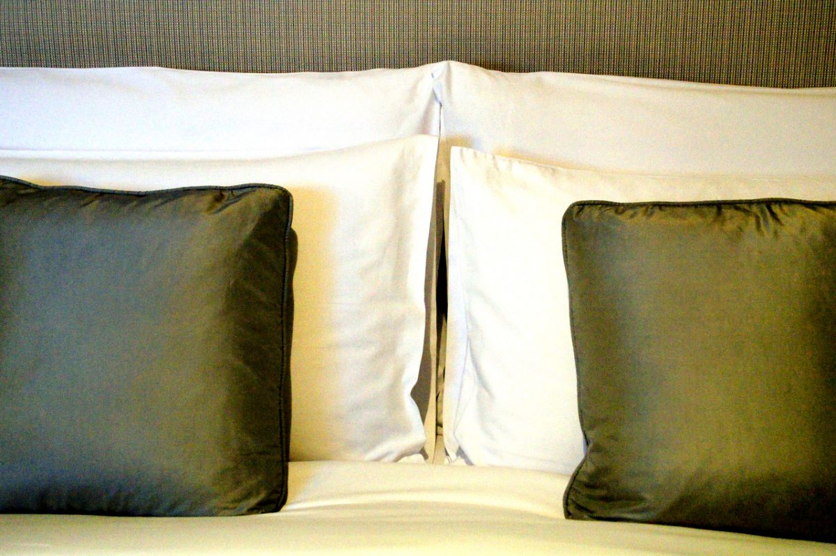 cushions on bed in bedroom in the oriental residence in bangkok thailand