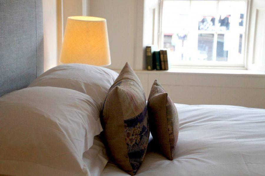 cushions on the bed in the premium double en suite room the Damson at the bel and dragon in odiham