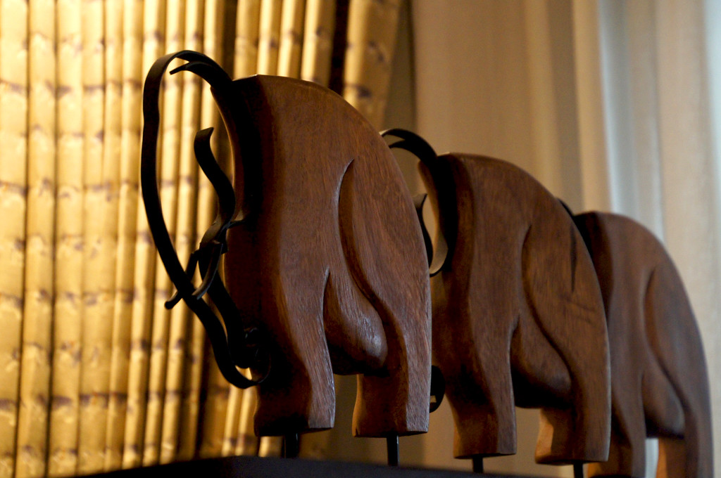 elephants in seating area in front of bed in our bedroom at 137 pillars house in chiang mai thailand