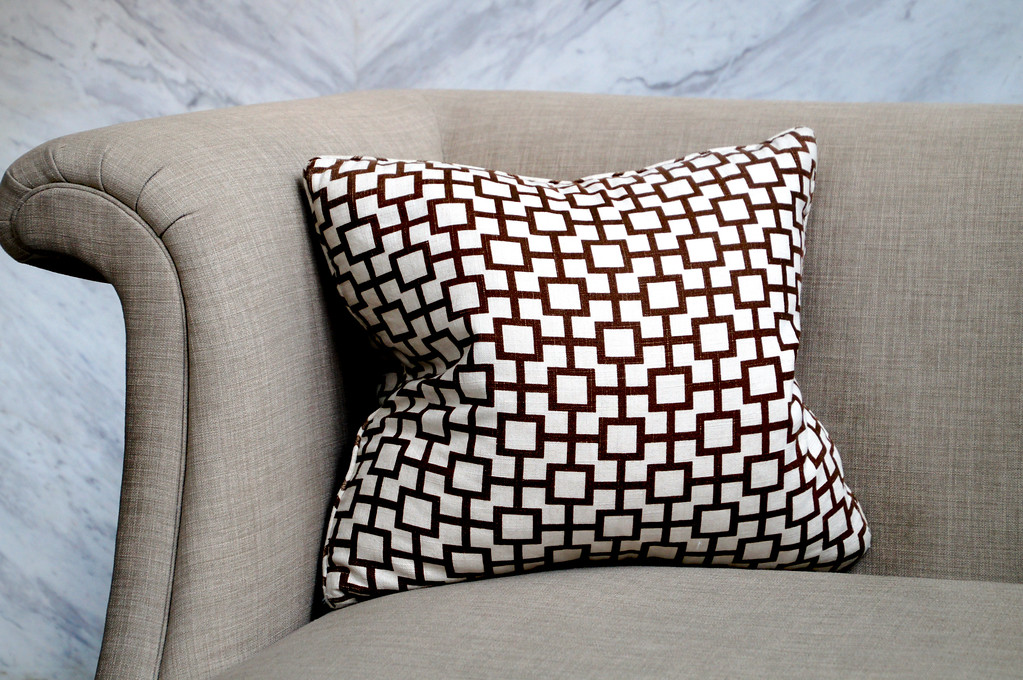 geometric cushion on grey seat in reception area of the oriental residence in bangkok thailand