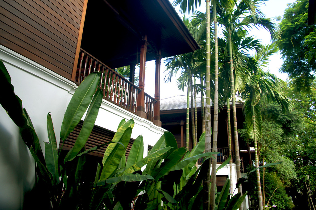 hotel room pavilions surrounded by trees at 137 pillars house in chiang mai thailand