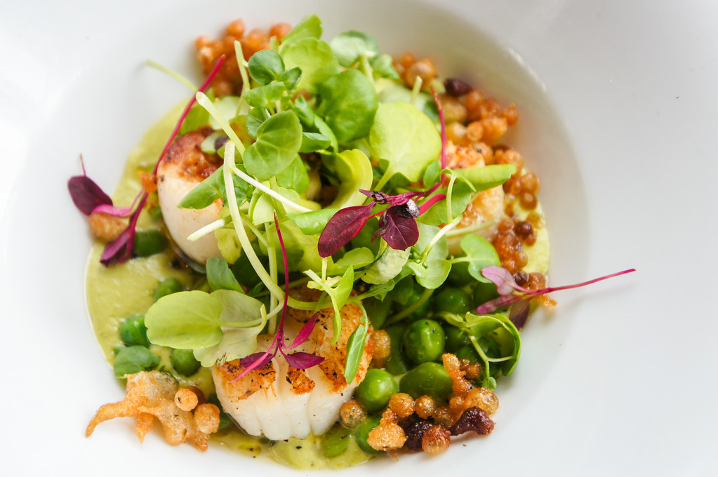 pan seared scallops with pea puree broadbeans and scraps starter Fire Stables in Wimbledon London picture 1