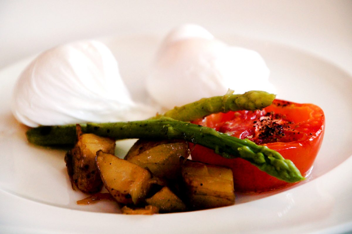 poached eggs and asparagus for breakfast at the oriental residence in bangkok thailand second picture