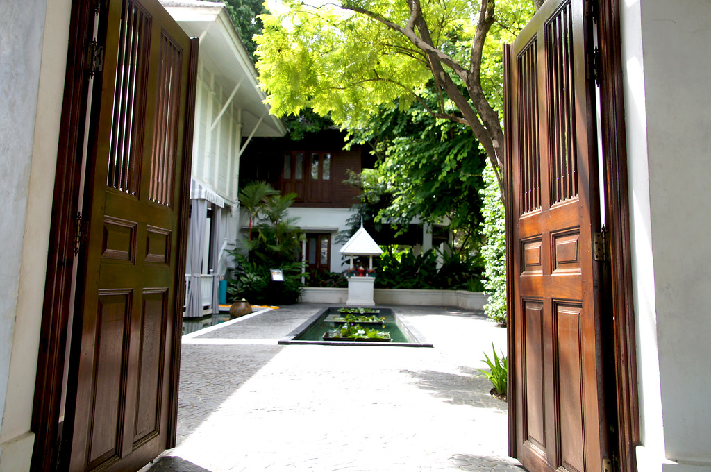 traditional thai timber doors in reception building at 137 pillars house in chiang mai thailand